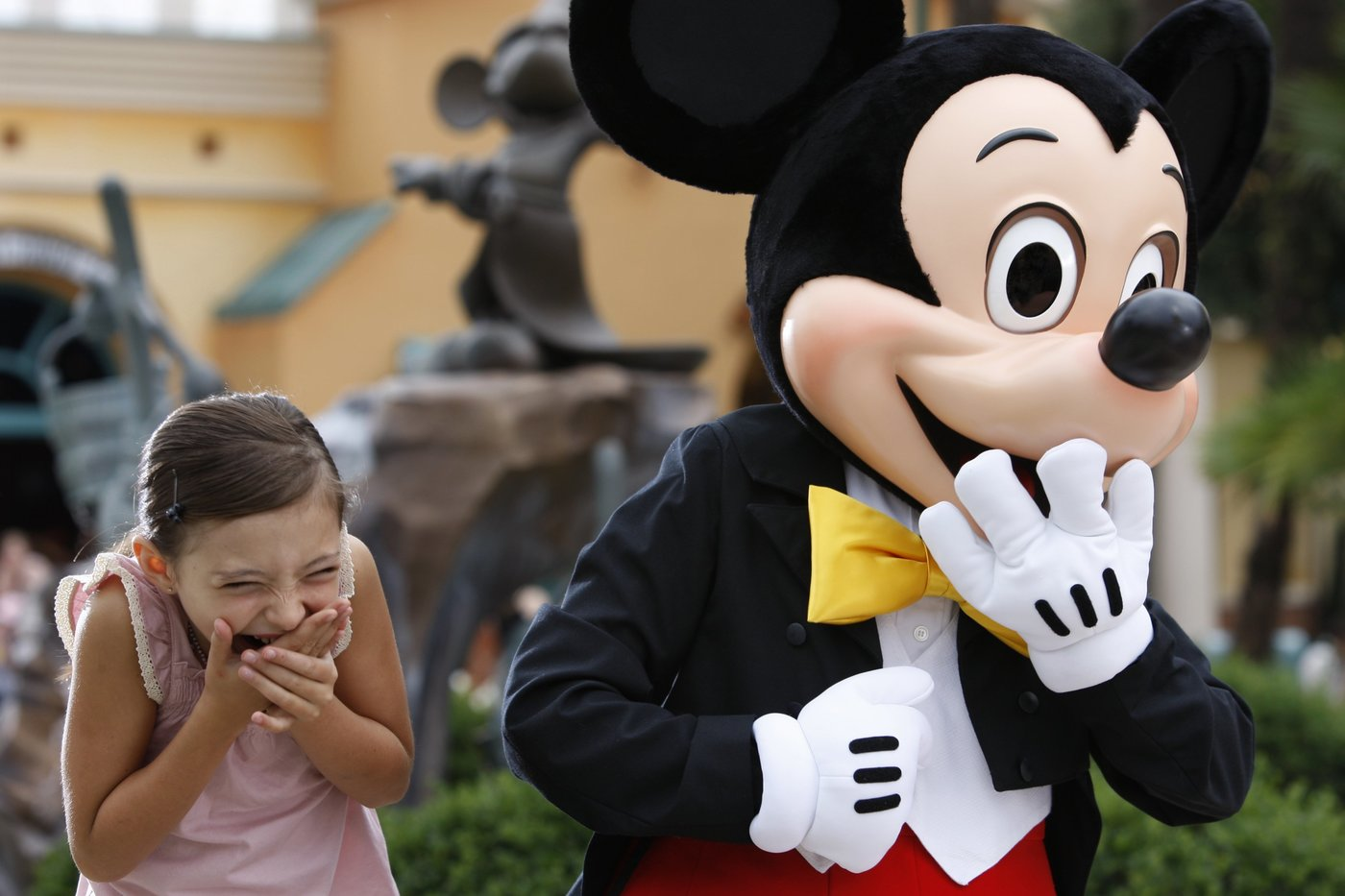 mickey and child laughing