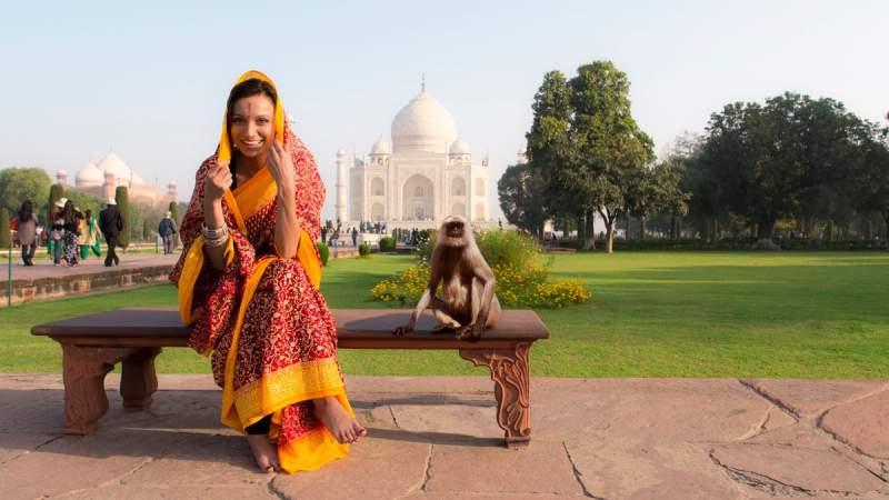 Indian woman with a monkey at Taj Mahal..