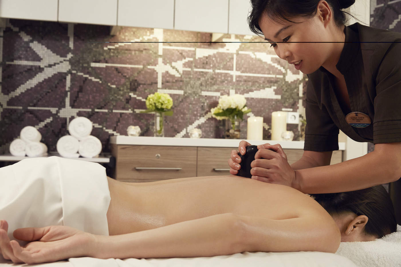 Massage, stone massage at spa, QN class, luxury massage, spa attendant and guest